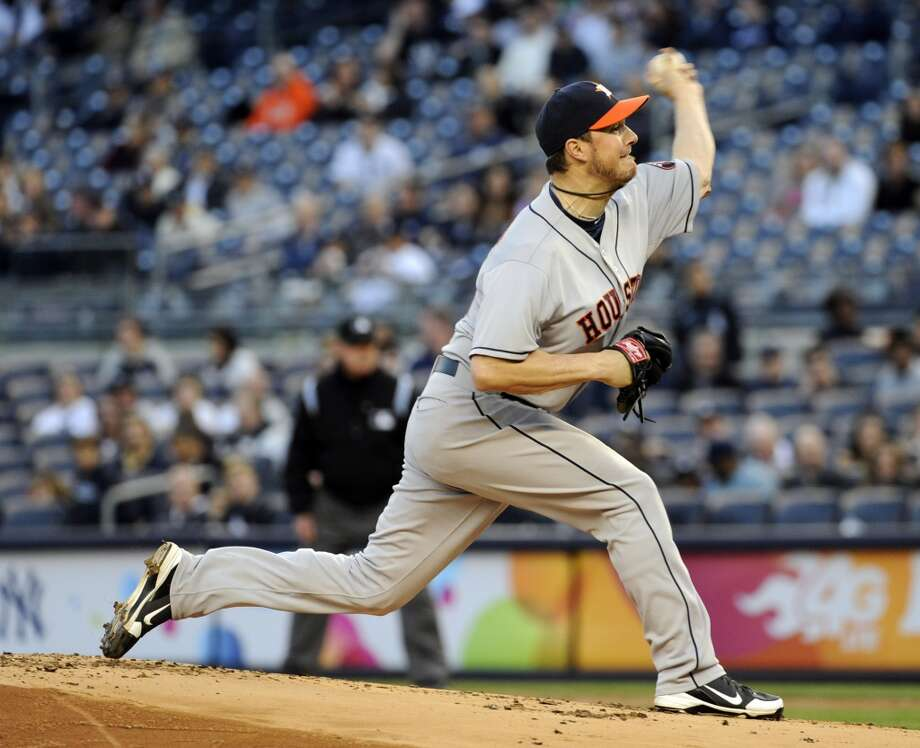 Astros pitcher Eric Bedard delivers the ball to the Yankees during the first inning. Photo: Bill Kostroun, Associated Press