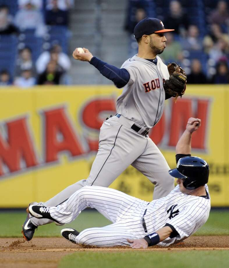 Jayson Nix is out at second base as Astros shortstop Marwin Gonzalez relays the ball to first to complete a double play.