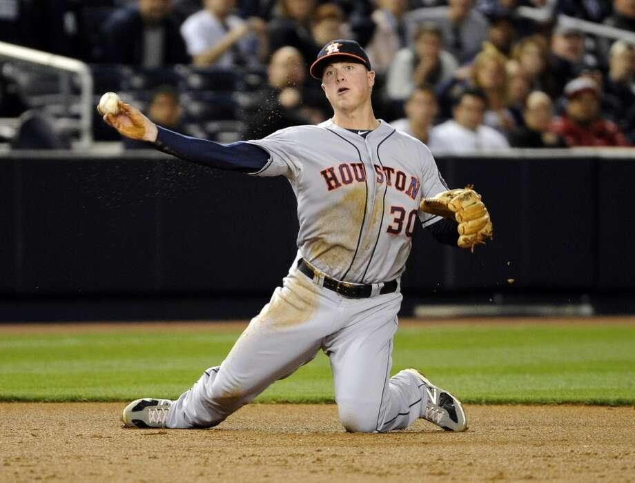 Astros third baseman Matt Dominguez throws out Eduardo Nunez. Photo: Bill Kostroun, Associated Press