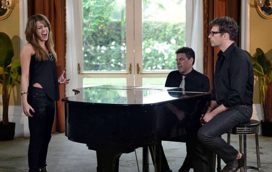 AMERICAN IDOL: Multi-talented artist Harry Connick, Jr mentors the final 4 on AMERICAN IDOL airing Wednesday, May, 1 (8:00-10:00 PM ET/PT) on FOX. Pictured: Angie Miller (L) and Harry Conick, Jr. (R). CR: Michael Becker / FOX. Copyright: FOX.