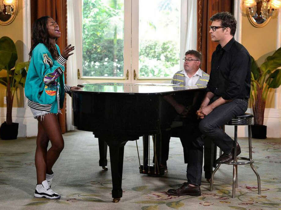 AMERICAN IDOL: Multi-talented artist Harry Connick, Jr mentors the final 4 on AMERICAN IDOL airing Wednesday, May, 1 (8:00-10:00 PM ET/PT) on FOX. L-R: Amber Holcomb and Harry Conick, Jr. CR: Michael Becker / FOX. Copyright: FOX.