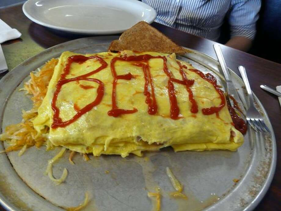 "Beth's Café is home to late-night, next-day-hungover-hungry grub, and the notorious 12-egg omelet. It comes on a pizza-pie plate, with ""all you can eat"" hash browns. Like you need hash browns with this. North of Green Lake, at 7311 Aurora Ave. N. (Photo: Peter L., on Yelp)."