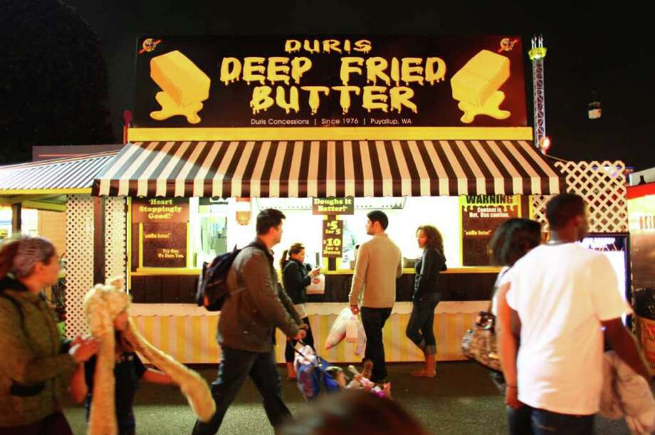 Deep-fried butter: You don't go to the Puyallup Fair for the 4-H exhibits, do you? You go there for the scones, cotton candy and elephant ears. And of course the deep-fried butter, otherwise known as gobs of fat fried in fat. Photo: JOSHUA TRUJILLO / SEATTLEPI.COM
