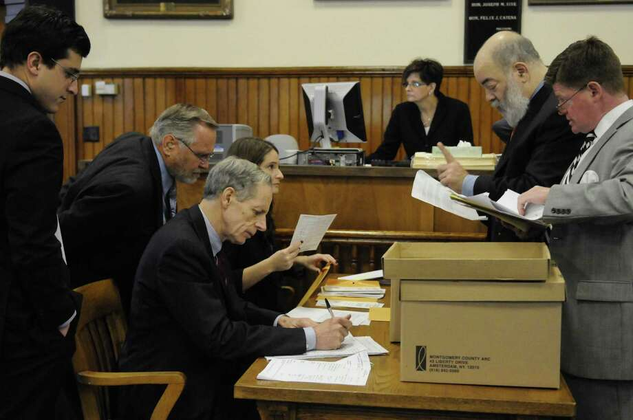 Ballot counting in the 46th senate district race between Democrat Celicia Tkaczyk and Republican George Amedore Friday Dec. 14, 2012, at the  Montgomery County Courthouse in Fonda., N.Y. (Michael P. Farrell/Times Union archive) Photo: Michael P. Farrell / 00020480A