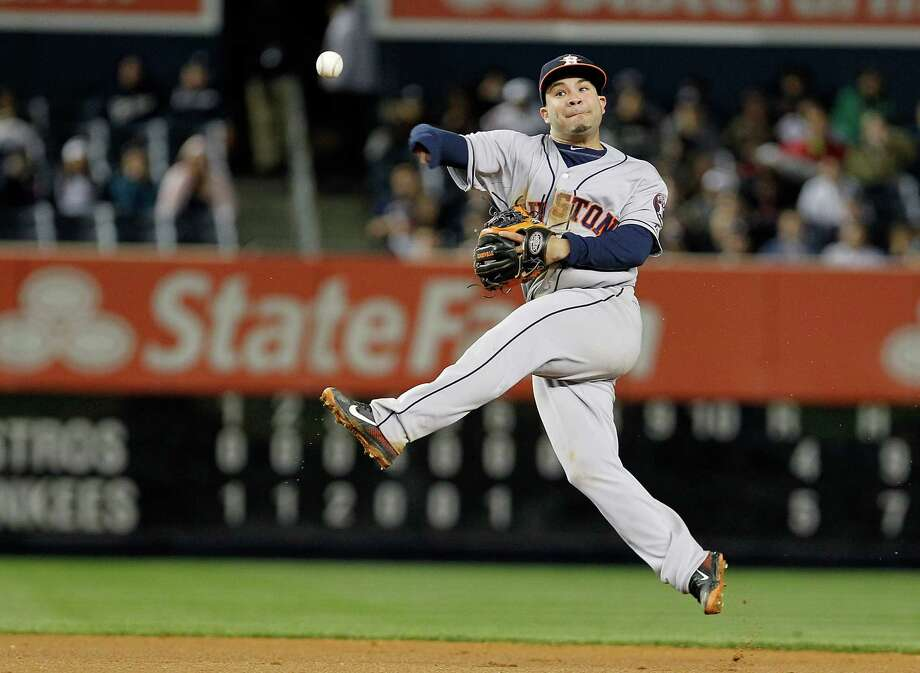 Astros second baseman Jose Altuve makes an acrobatic play during Wednesday night's 5-4 loss at Yankee Stadium. Photo: Mike Stobe, Stringer / 2013 Getty Images