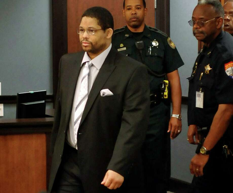 FILE - In this April 22, 2013 file photo, Bartholomew Granger, left, enters court for the start of his trial in Galveston, Texas. The Houston man who admitted shooting his daughter outside a Texas courthouse was convicted Tuesday, April 30, of capital murder for the death of a 79-year-old bystander. Granger said he was angry with his daughter for testifying against him in a sex assault case. (AP Photo/The Beaumont Enterprise, Dave Ryan) Photo: Dave Ryan, MBO / The Beaumont Enterprise