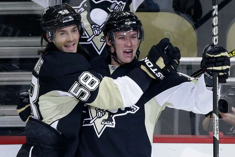 The Penguins didn't miss Sidney Crosby one bit in their playoff opener as Beau Bennett, right, with Kris Letang, scored after only 3:30 to ignite a 5-0 rout. Photo: Gene J. Puskar, STF / AP