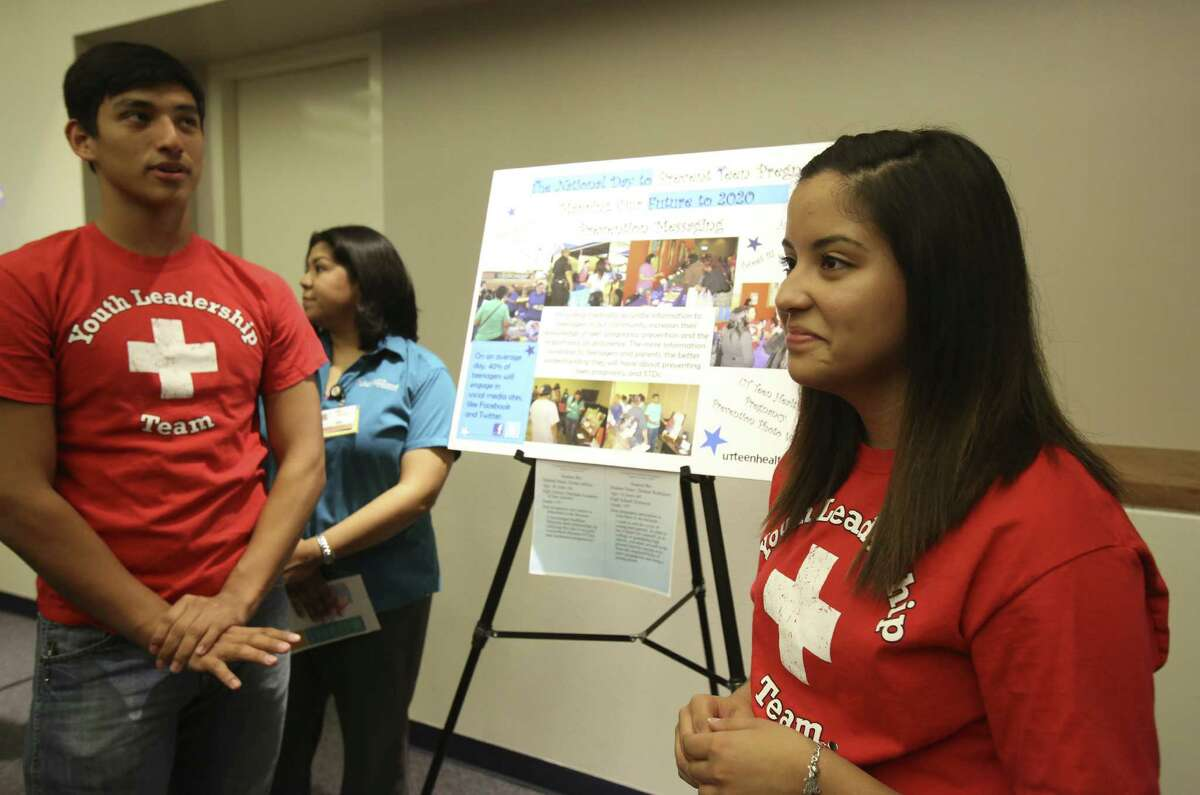 Thomas Rodriguez, 16, and Elisha Jeffries, 16, speak about their poster as part of Metro Health's Project WORTH program during the National Day to Prevent Teen Pregnancy.