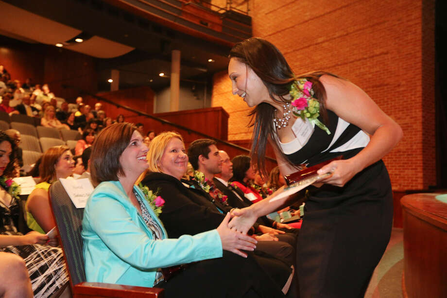 Fifth-grade teachers Charlotte Dolat (left) of Alamo Heights ISD and Isabel Anaya of Northside ISD congratulate each other after they were honored with the Trinity Prize for Excellence in Teaching during a ceremony at the campus. Photo: Jerry Lara / San Antonio Express-News