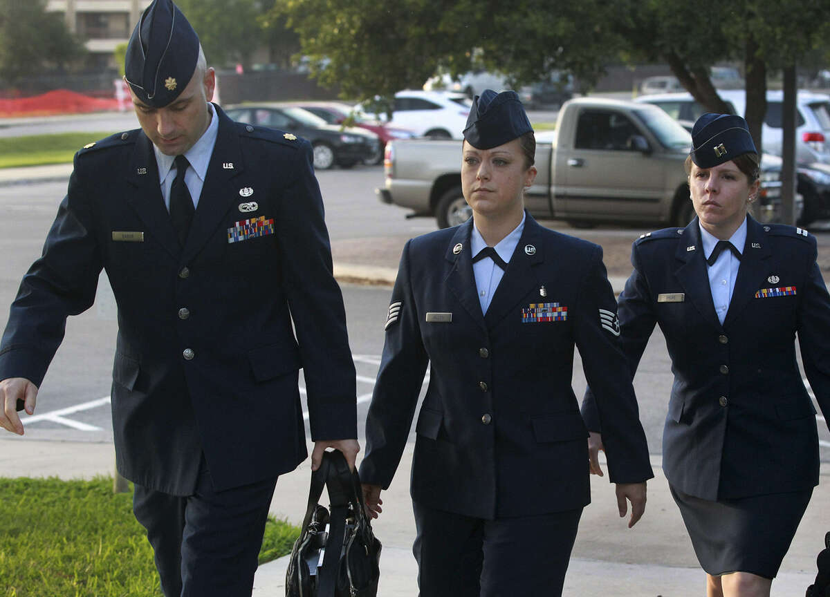 U.S. Air Force Staff Sgt. Emily Allen (center) enters a hearing Wednesday. She is the first woman instructor charged in the sex-abuse scandal at Joint Base San Antonio-Lackland.