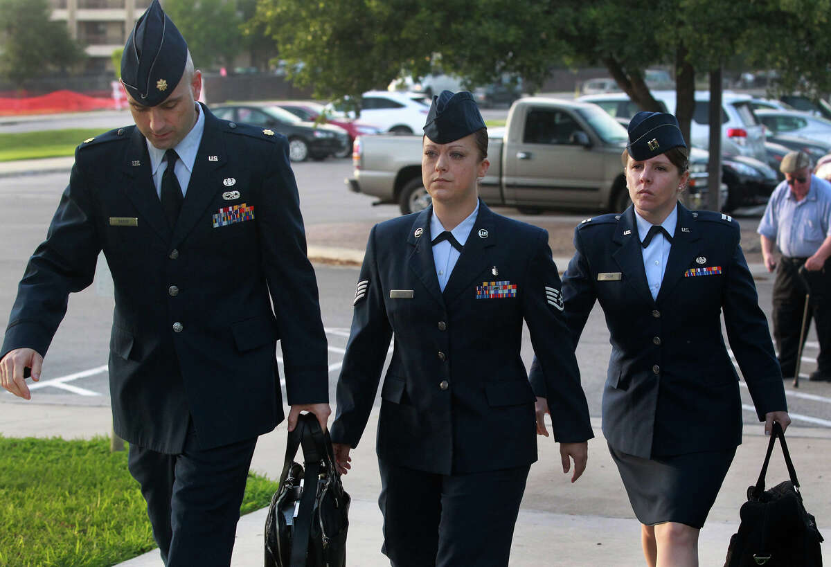 U.S. Air Force Staff Sergeant Emily Allen (center) walks to a hearing Wednesday May 1, 2013 at Joint Base San Antonio-Lackland. Allen is the first woman basic training instructor charged in the scandal at Joint Base San Antonio-Lackland and is charged with having sex with a trainee.