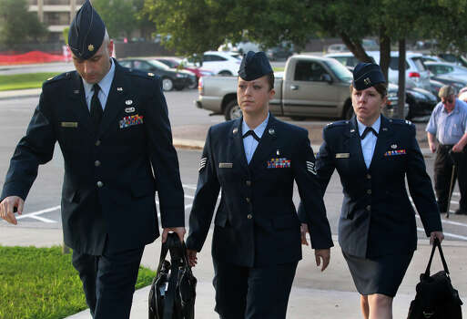U.S. Air Force Staff Sergeant Emily Allen (center) walks to a hearing Wednesday May 1, 2013 at Joint Base San Antonio-Lackland. Allen is the first woman basic training instructor charged in the scandal at Joint Base San Antonio-Lackland and is charged with having sex with a trainee. Photo: SAN ANTONIO EXPRESS-NEWS / ©San Antonio Express-News/Photo may be sold to the public