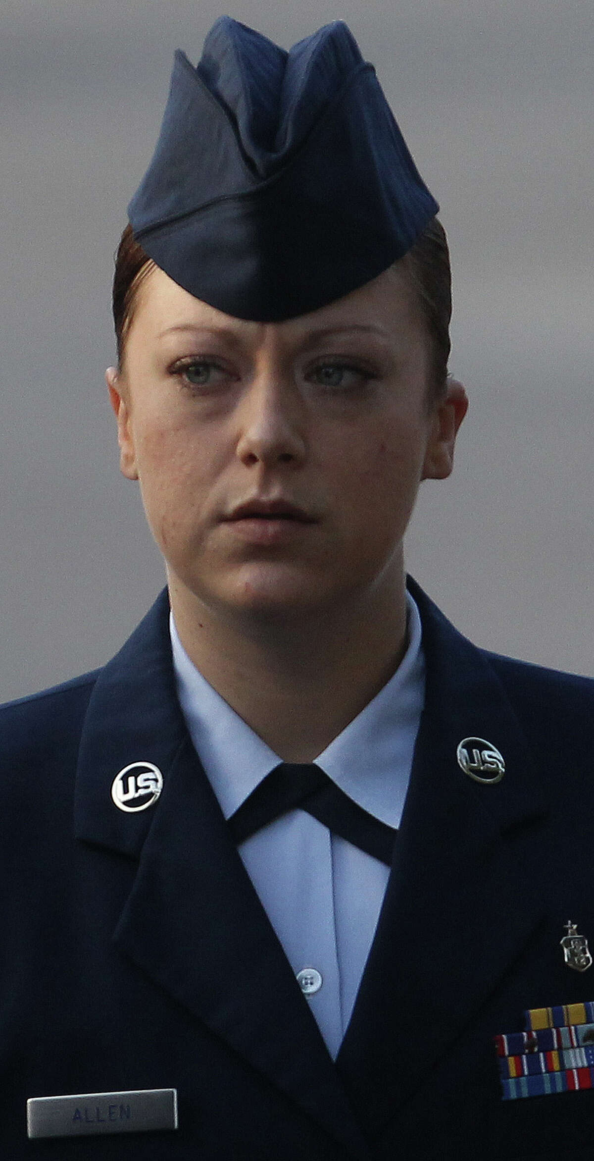 U.S. Air Force Staff Sergeant Emily Allen walks to a hearing Wednesday May 1, 2013 at Joint Base San Antonio-Lackland. Allen is the first woman basic training instructor charged in the scandal at Joint Base San Antonio-Lackland and is charged with having sex with a trainee.