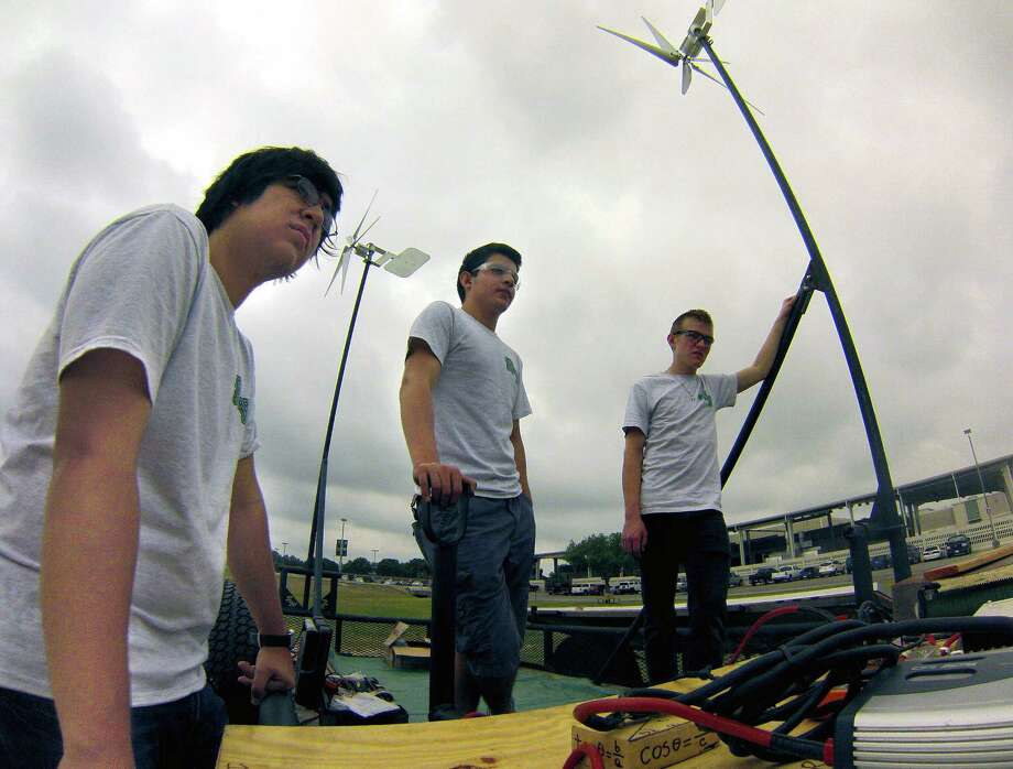 Southwest High School engineering team members Edgar Gomez (from left), Rolando Melendez and Tristan Mabe build a portable wind-turbine refueling station to be used to charge electric cars. Photo: Photos By Billy Calzada / San Antonio Express-News