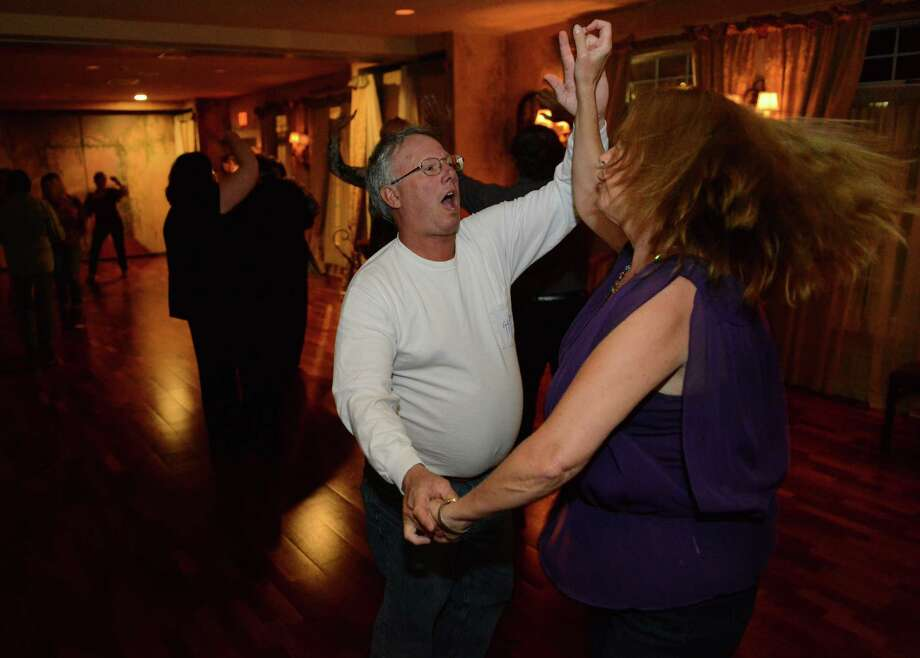Lee and Lisa Pepin, of Ridgefield, dance at the Oldies Feel Good dance at La Fortuna restaurant in Bethel, Conn. on Wednesday, May 1, 2013.  The dance featured DJ Bongo Joe playing 50's through 90's music to a crowd of over 100 people.  The Oldies Feel Good dance has been at La Fortuna for about two months and is held every Wednesday night from 8 p.m. until midnight. Photo: Tyler Sizemore / The News-Times