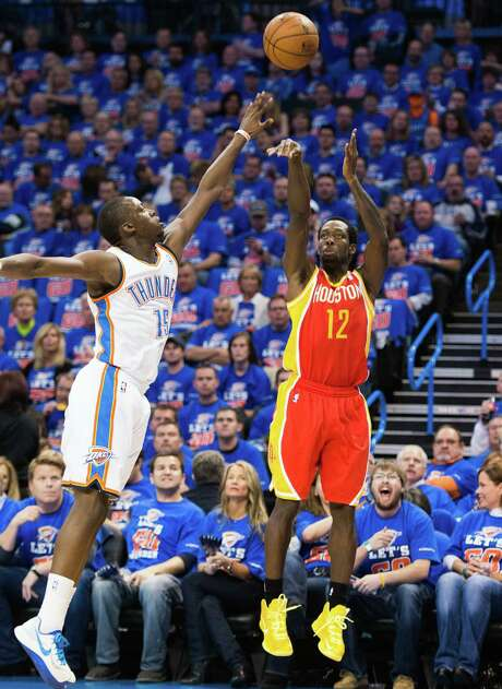 Patrick Beverley joins in the 3-point parade, shooting over the Thunder's Reggie Jackson as the Rockets went 14-for-35 Wednesday night from long range. Photo: Smiley N. Pool, Staff / © 2013  Houston Chronicle