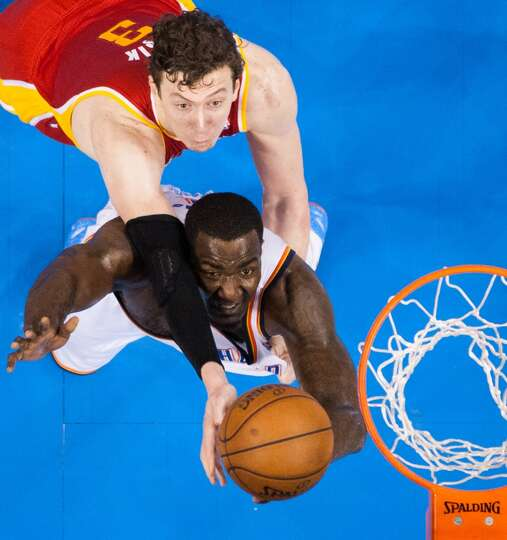 May 1: Rockets 107, Thunder 100Rockets center Omer Asik fights for a rebound