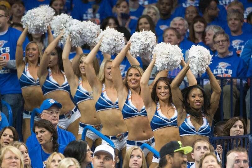 Thunder cheerleaders perform.