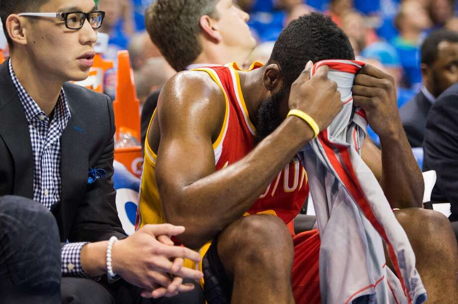 Rockets point guard Jeremy Lin and shooting guard James Harden watch from the bench. Photo: Smiley N. Pool, Houston Chronicle