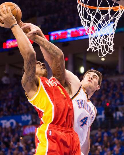 Rockets power forward Greg Smith is fouled by Thunder power forward Nick Collison.