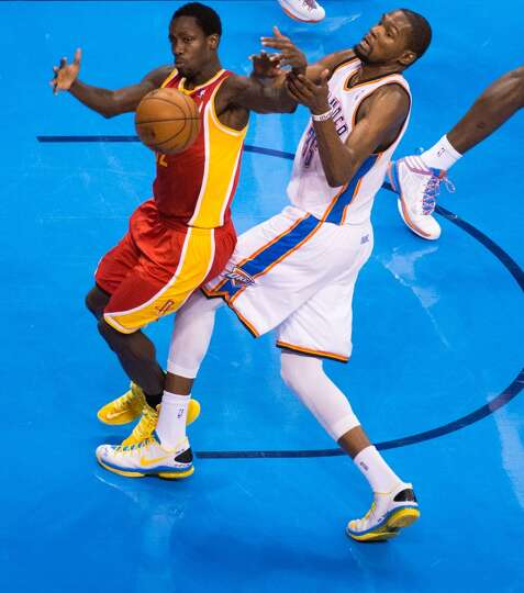 Rockets point guard Patrick Beverley takes a rebound away from Thunder small forward Kevin Durant.