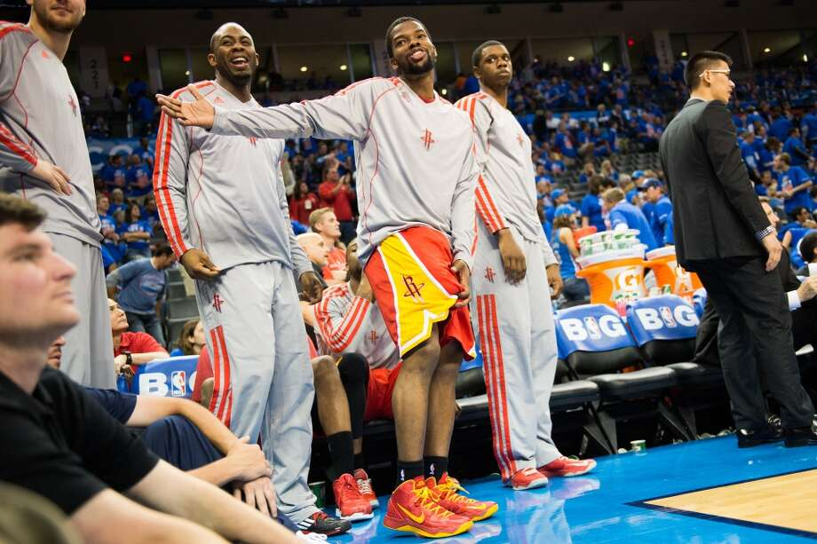 Rockets point guard Aaron Brooks motions to the Thunder fans during the second half. Photo: Smiley N. Pool, Houston Chronicle