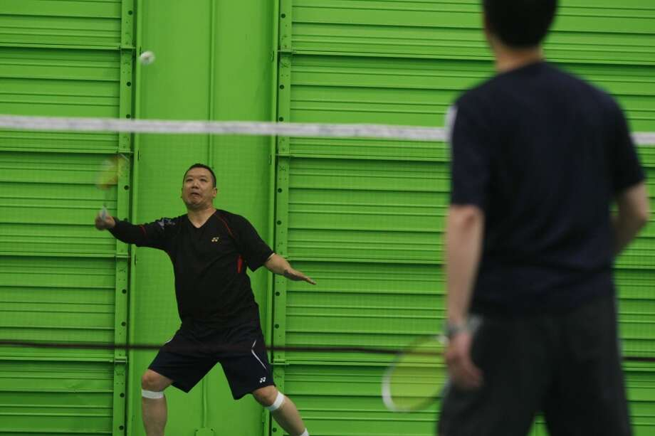 Ray Ng returns the birdie at the California Badminton Academy in Fremont, Calif. on Saturday April 27 2013. Badminton is the first event of the Bay Area Senior Games which takes place over six weeks