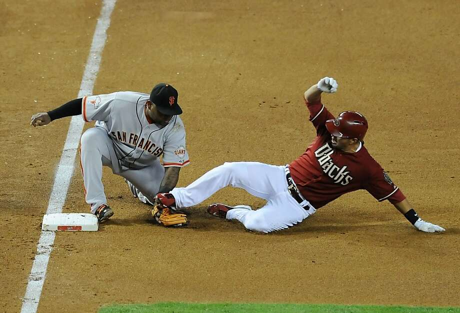 PHOENIX, AZ - MAY 01:  Pablo Sandoval #48 of the San Francisco Giants tags out Eric Chavez #12 of the Arizona Diamondbacks at third base at Chase Field on May 1, 2013 in Phoenix, Arizona.  (Photo by Norm Hall/Getty Images) Photo: Norm Hall, Getty Images