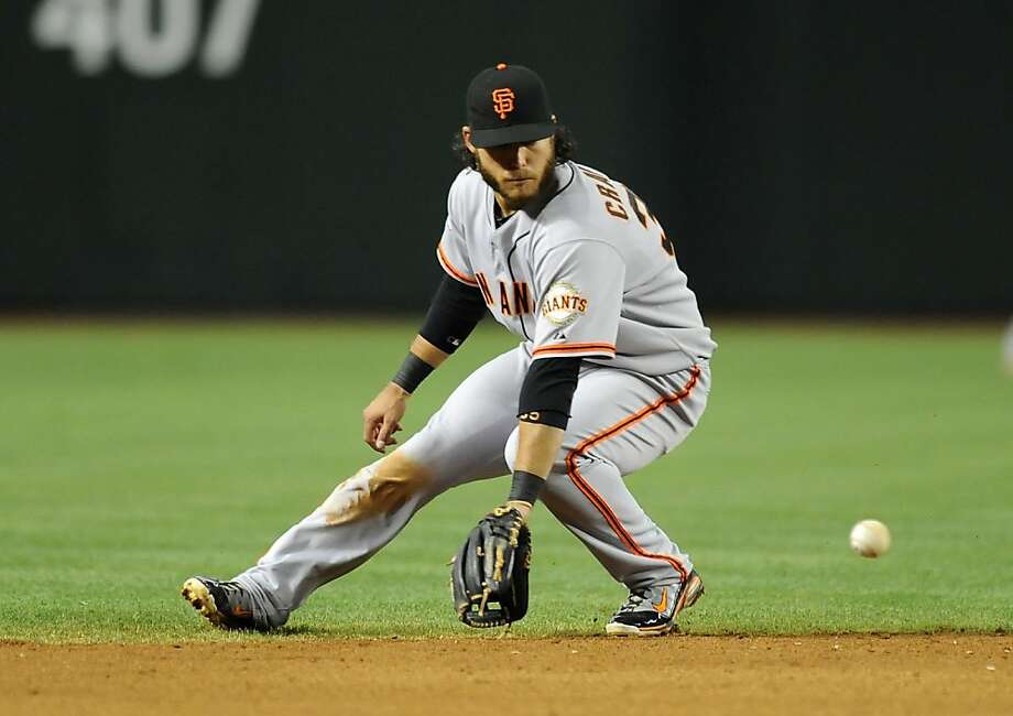 PHOENIX, AZ - MAY 01:  Brandon Crawford #35 of the San Francisco Giants makes a backhanded play on a ground ball against the Arizona Diamondbacks slides at Chase Field on May 1, 2013 in Phoenix, Arizona.  (Photo by Norm Hall/Getty Images) Photo: Norm Hall, Getty Images