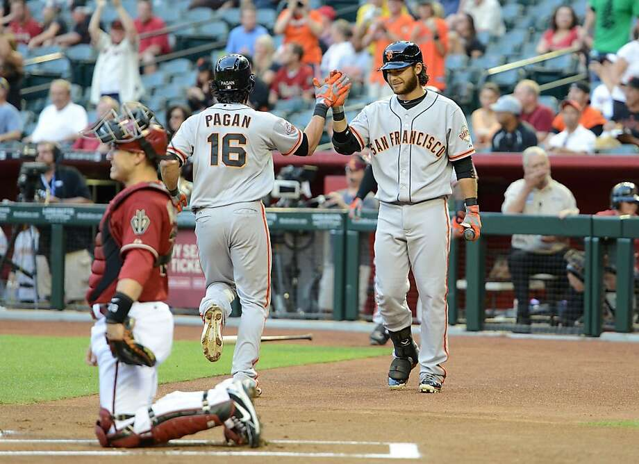 PHOENIX, AZ - MAY 01:  Angel Pagan #16 of the San Francisco Giants celebrates with teammate Brandon Crawford #35 after hitting a lead off home run against the Arizona Diamondbacks at Chase Field on May 1, 2013 in Phoenix, Arizona.  (Photo by Norm Hall/Getty Images) Photo: Norm Hall, Getty Images