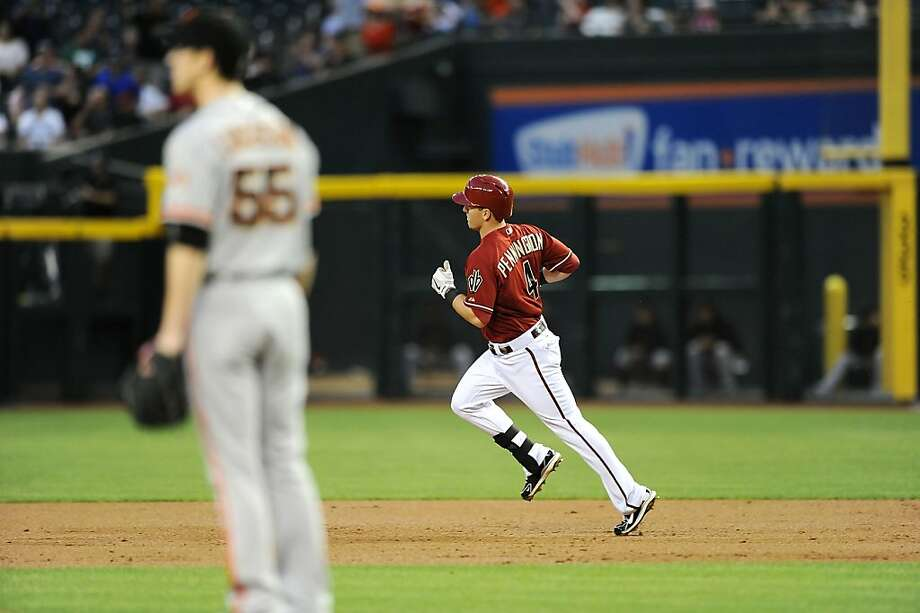PHOENIX, AZ - MAY 01:  Cliff Pennington #4 of the Arizona Diamondbacks rounds the bases after hitting a three-run home run in the second inning against Tim Lincecum #55 of the San Francisco Giants at Chase Field on May 1, 2013 in Phoenix, Arizona.  (Photo by Norm Hall/Getty Images) Photo: Norm Hall, Getty Images