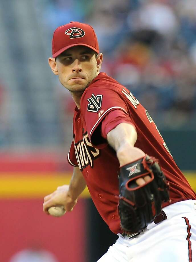 PHOENIX, AZ - MAY 01:  Brandon McCarthy #32 of the Arizona Diamondbacks delivers a pitch in the first inning against the San Francisco Giants at Chase Field on May 1, 2013 in Phoenix, Arizona.  (Photo by Norm Hall/Getty Images) Photo: Norm Hall, Getty Images