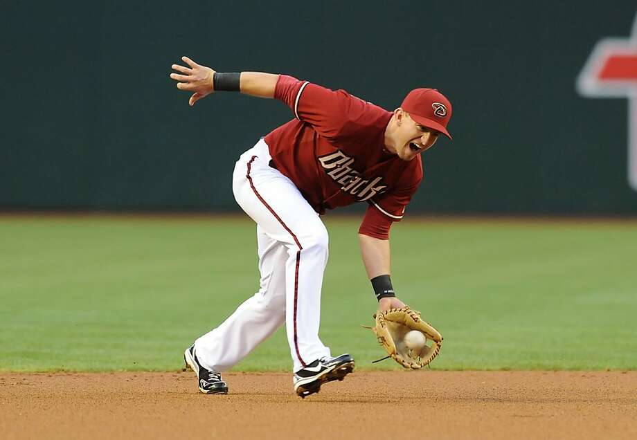PHOENIX, AZ - MAY 01:  Cliff Pennington #4 of the Arizona Diamondbacks makes a play on a ground ball against the San Francisco Giants at Chase Field on May 1, 2013 in Phoenix, Arizona.  (Photo by Norm Hall/Getty Images) Photo: Norm Hall, Getty Images