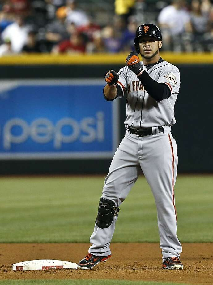 San Francisco Giants' Gregor Blanco pumps his fists together after hitting a double against the Arizona Diamondbacks during the fifth inning of a baseball game, on Wednesday, May 1, 2013, in Phoenix. (AP Photo/Ross D. Franklin) Photo: Ross D. Franklin, Associated Press