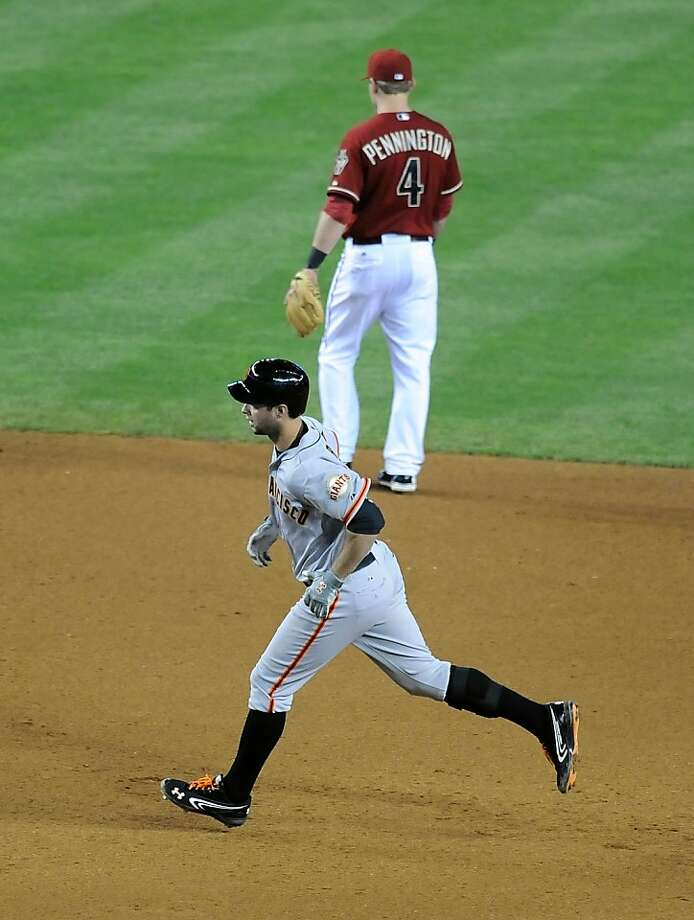 PHOENIX, AZ - MAY 01:  Brandon Belt #9 rounds the bases after hitting a three-run home run against the Arizona Diamondbacks at Chase Field on May 1, 2013 in Phoenix, Arizona.  (Photo by Norm Hall/Getty Images) Photo: Norm Hall, Getty Images