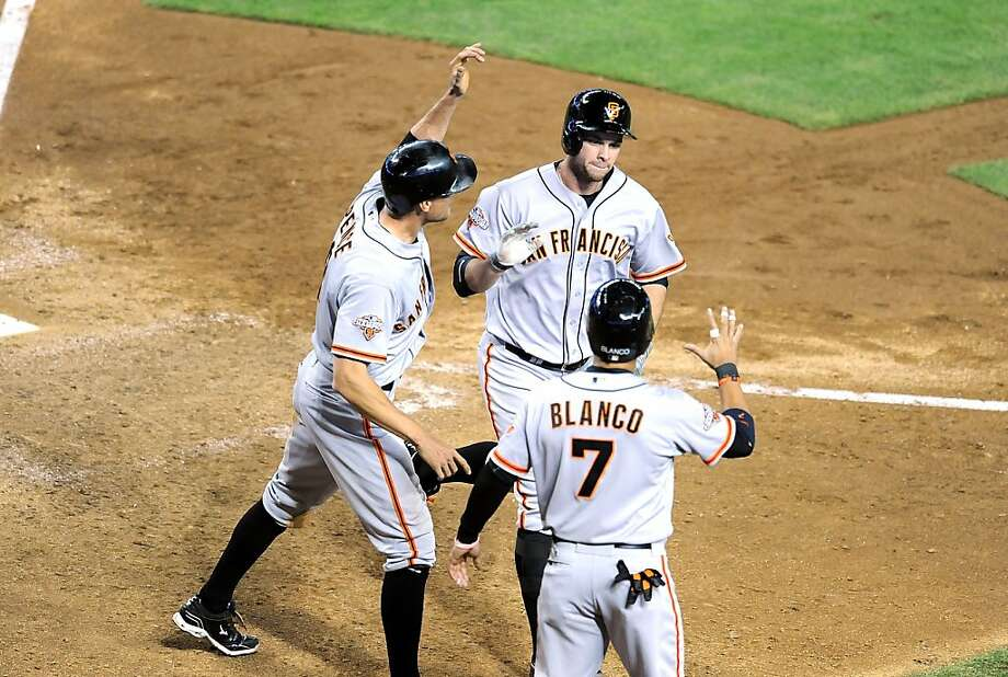 PHOENIX, AZ - MAY 01:  Brandon Belt #9 of the San Francisco Giants celebrates a three-run home run with teammates Gregor Blanco #7 and Hunter Pence #8 against the Arizona Diamondbacks at Chase Field on May 1, 2013 in Phoenix, Arizona.  (Photo by Norm Hall/Getty Images) Photo: Norm Hall, Getty Images