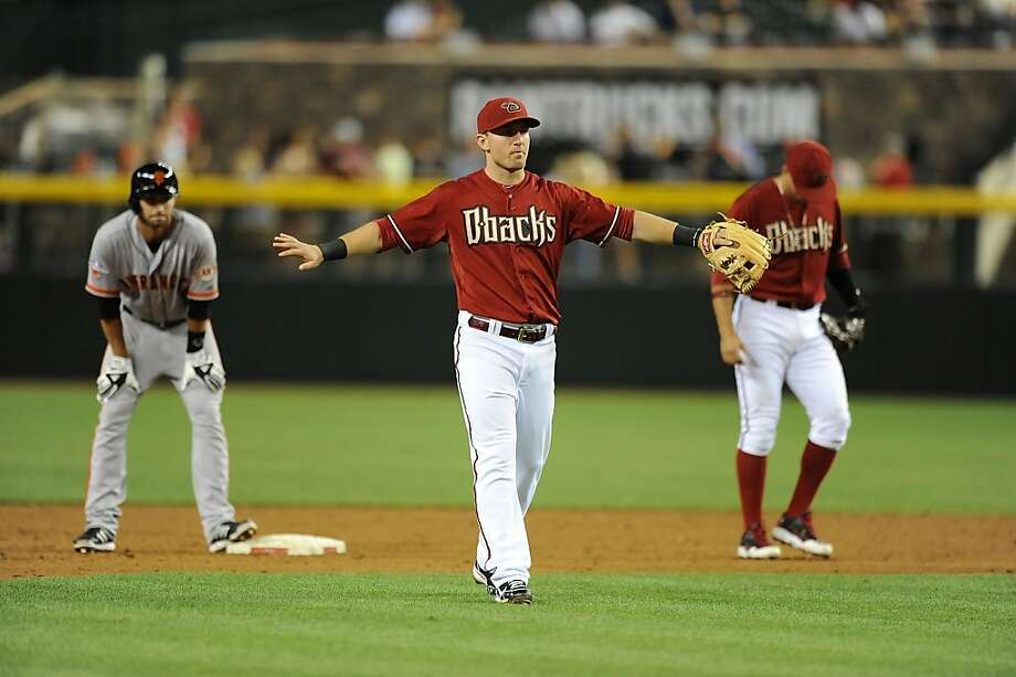 PHOENIX, AZ - MAY 01:  Cliff Pennington #4 of the Arizona Diamondbacks signals to his teammates against the San Francisco Giants at Chase Field on May 1, 2013 in Phoenix, Arizona.  (Photo by Norm Hall/Getty Images) Photo: Norm Hall, Getty Images