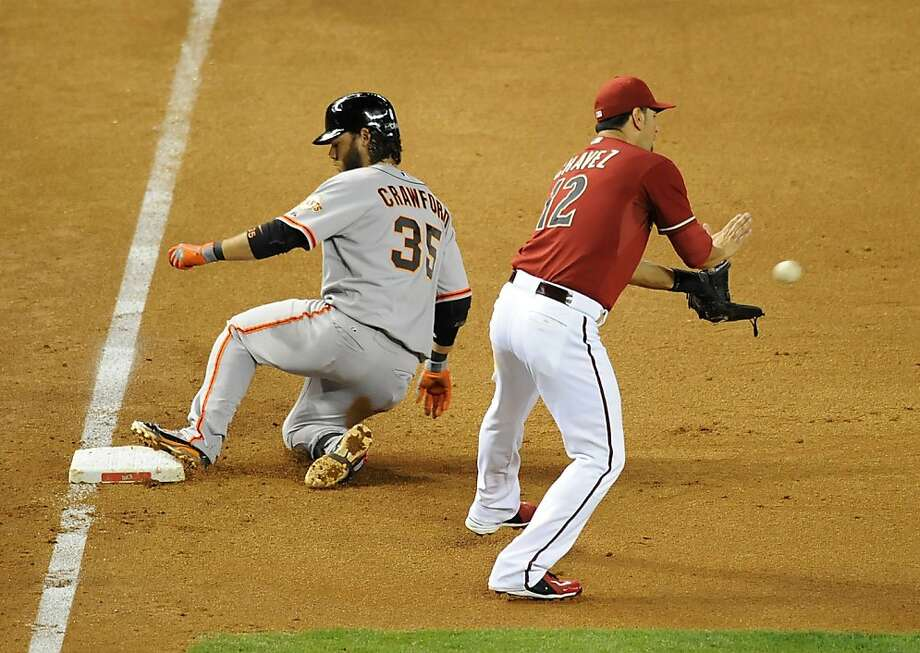 PHOENIX, AZ - MAY 01:  Brandon Crawford #35 of the San Francisco Giants slides into third base after hitting a triple as Eric Chavez #12 of the Arizona Diamondbacks catches a throw from the outfield at Chase Field on May 1, 2013 in Phoenix, Arizona.  (Photo by Norm Hall/Getty Images) Photo: Norm Hall, Getty Images