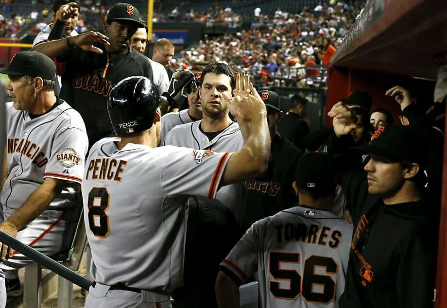 San Francisco Giants' Hunter Pence (8) gets high-fives from teammates after his home run against the Arizona Diamondbacks during the sixth inning of a baseball game on Wednesday, May 1, 2013, in Phoenix. (AP Photo/Ross D. Franklin) Photo: Ross D. Franklin, Associated Press