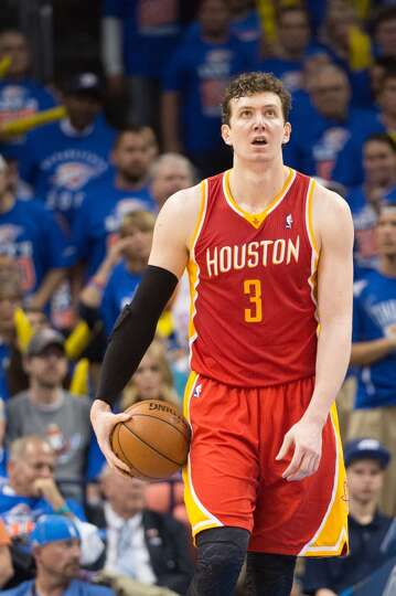 Rockets center Omer Asik reacts after being fouled.