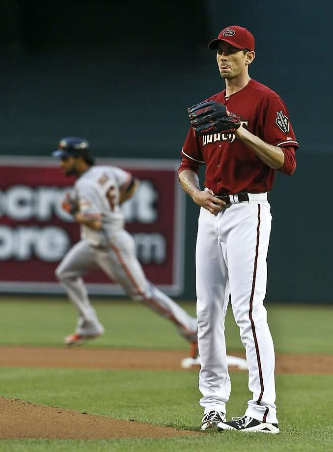 Arizona Diamondbacks' Brandon McCarthy, right, waits for a new ball as San Francisco Giants' Angel Pagan, left, rounds the bases after hitting a home run during the first inning of a baseball game on Wednesday, May 1, 2013, in Phoenix. (AP Photo/Ross D. Franklin) Photo: Ross D. Franklin, Associated Press