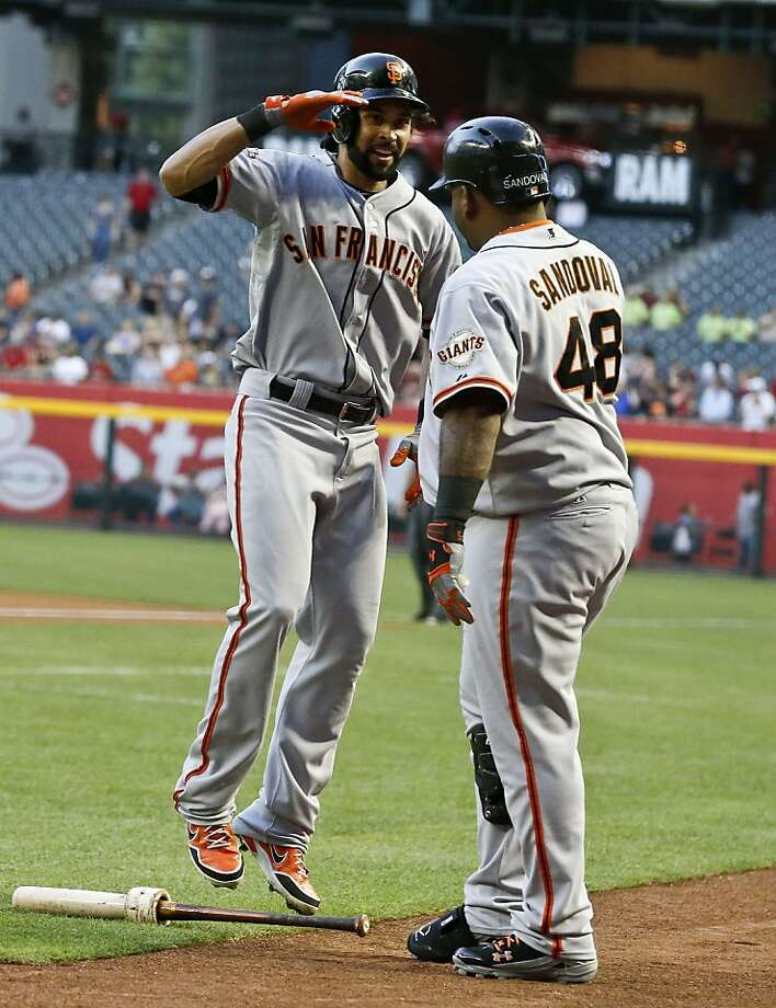 San Francisco Giants' Angel Pagan, left, salutes teammate Pablo Sandoval (48) after hitting a home run against the Arizona Diamondbacks during the first inning of a baseball game on Wednesday, May 1, 2013, in Phoenix. (AP Photo/Ross D. Franklin) Photo: Ross D. Franklin, Associated Press