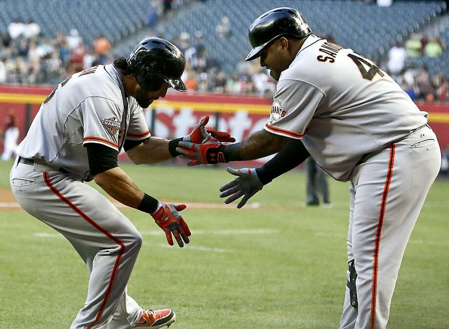 San Francisco Giants' Angel Pagan, left, celebrates his home run against the Arizona Diamondbacks with teammate Pablo Sandoval during the first inning of a baseball game on Wednesday, May 1, 2013, in Phoenix. (AP Photo/Ross D. Franklin) Photo: Ross D. Franklin, Associated Press