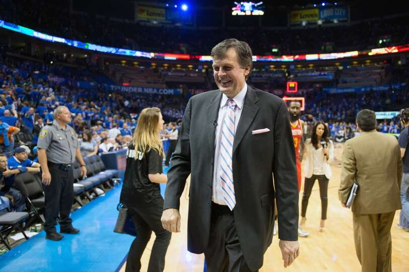 Rockets head coach Kevin McHale smiles as he leaves the court.
