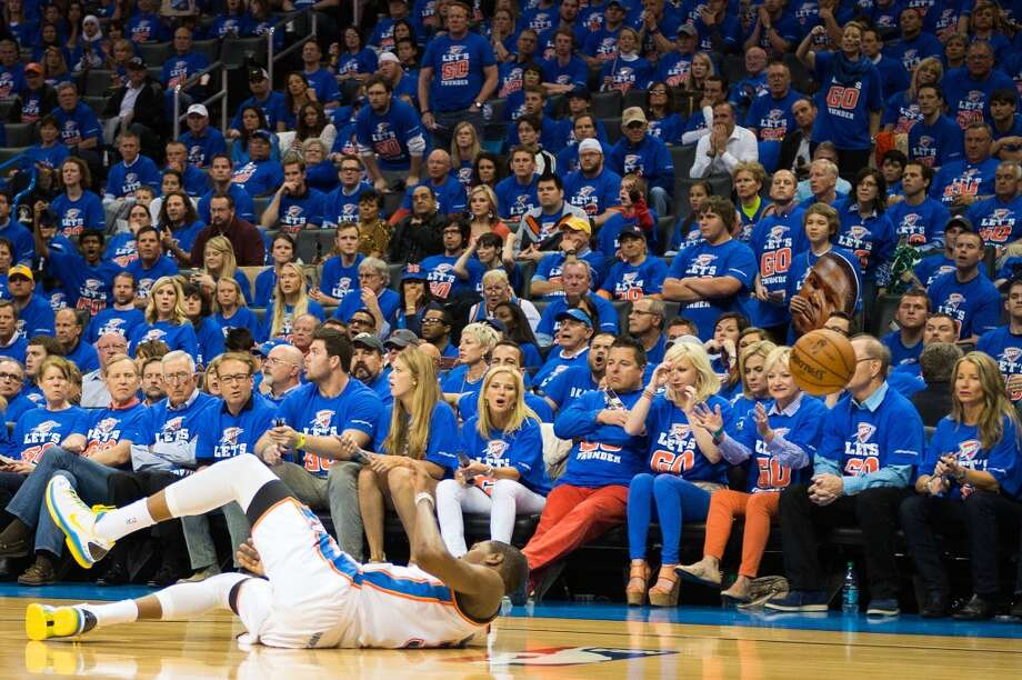 Thunder fans react as Kevin Durant tumbles to the floor.  Durant had  36 point in the game, but was scoreless in the fourth quarter. Photo: Smiley N. Pool, Houston Chronicle