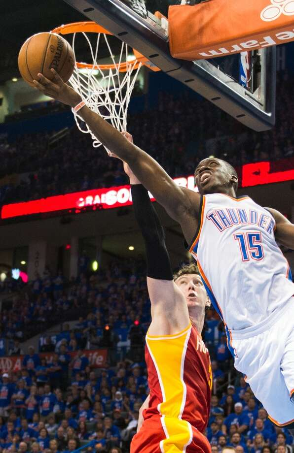 Rockets center Omer Asik defends a drive by Thunder point guard Reggie Jackson. Photo: Smiley N. Pool, Houston Chronicle