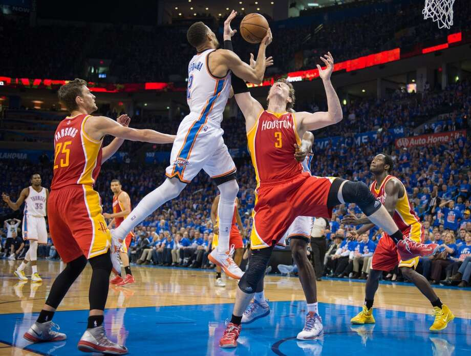 Rockets center Omer Asik fights for a rebound against Thunder shooting guard Thabo Sefolosha. Photo: Smiley N. Pool, Houston Chronicle