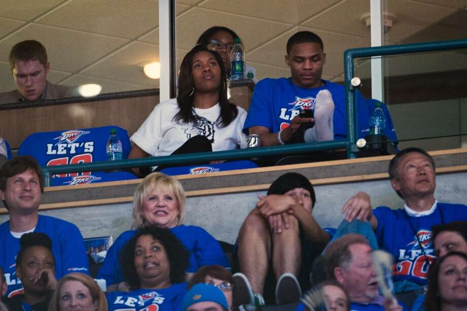 Injured Thunder point guard Russell Westbrook props his leg up as he watches the game from a suite. Photo: Smiley N. Pool, Houston Chronicle