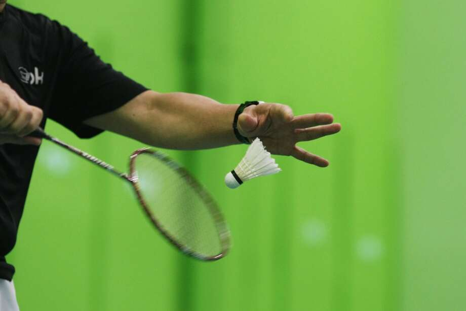 Yee Tantiyavarong serves the birdie during the Bay Area Senior Games at the California Badminton Academy in Fremont, Calif. on Saturday, April 27 2013. Badminton is the first event of the Bay Area Senior Games which takes place over six weeks