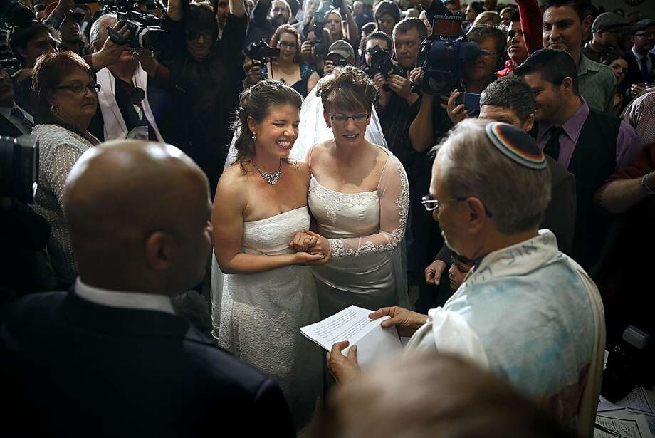 DENVER, CO - MAY 1: Anna (L) and Fran Simon, both of Denver, Colorado, are the first same-sex couple to be issued a Civil Union license at a midnight ceremony in the Denver Office of the Clerk and Recorder, at the Wellington E. Webb Municipal Office Building on May 1, 2013 in Denver, Co. Colorado is the eighth state to have civil unions or similar laws implemented, permitting unmarried couples, both gay and heterosexual, the ability to form civil unions and get similar rights to those of married couples.  (Photo by Marc Piscotty/Getty Images) *** BESTPIX *** Photo: Marc Piscotty, Getty Images